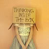 "jesse_the_k: Female head inside a box, with words ""Thinking inside the box"" scrawled on it. (thinking inside the box)"