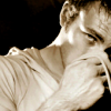 anshin: Sepia-toned picture of Chris Evans looking bashful. (chris)