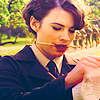 muccamukk: Peggy holds a pencil between her teeth and studies a clipboard. (Cap: Preoccupied)