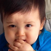kate_nepveu: closeup of toddler holding hand to mouth with furrowed brow (The Pip - serious eating (2012-11))