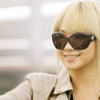 votary_rotary: CL wearing sun glasses and smiling. (Default)