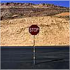 auburn: stop sign against hilly background (Stop)