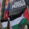 ajnabieh: Palestinian flag in front of billboard for the movie Prince of Persia.   (prince of persia)