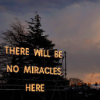 minna: there will be no miracles here in fluoro lettering over a tree at dusk ([MISC] no miracles)