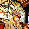 mary: A picture of a woman sitting in front of a stained glass window, from Tarantino's Inglourious Basterds ([misc] modern saint)