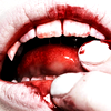 thepassenger: closeup of a person with fangs and bloody mouth touching their blood-soaked tongue. (do you hunger for this)