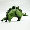 kaberett: A green origami stegosaurus (origami stegosaurus)