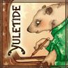 chomiji: A bear wearing pajamas, sitting at a desk, writing, with caption Yuletide (Yuletide Bear-Author)