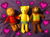 fairestcat: a stuffed bear, cat and monkey surrounded by photoshopped hearts (Cat/Bear/Monkey OTP)