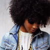 timeasmymeasure: girl with gorgeous afro looking down with a small smile (stock: afro smiles)