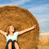 gwaihiril: woman sitting against a bale of hay (hay)