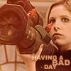 mercredigirl: Buffy Summers holding a rocket launcher (Buffy + rocket launcher)