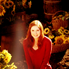 kouredios: Amy Pond, red sweater, surrounded by Vincent's sunflowers (DW!Amysunflowers)