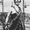 were_duck: lady gaga black and white photo of her draped in chains and wearing cigarette sunglasses (Gaga In Chains)