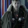 jesse_the_k: John Watson makes a sad face while holding open a winter coat stuffed with plastic explosive (JW hates semtex)