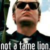 petra: Gene Hunt in sunglasses, with a gun, scowling. Text: Not a tame lion. (Gene - Not a tame lion)