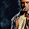 leroux: Callum Keith Rennie as Billy Tallent in Hard Core Logo, looking down with a cigarette hanging out of his mouth. (hard core logo)