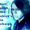 """amilyn: Sarah Connor with a big-ass gun, surrounded by blue light and the words, """"Hell, yeah, the chick's in charge."""" (chick in charge)"""