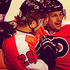 puckling: Claude Giroux turning in towards Danny Briere while they're both in hockey gear (Briouxs)