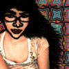 ajnabi: cartoonic photomanip of my face (with some body) against a colourful patterned background (i promise to fly)