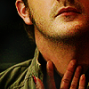 anaraine: Crop of Gabriel's lower face and neck, with Kali's fingers touching his throat (from 5.19) ([spn] touch)