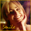 thedivinegoat: Photo: Megan from Numb3rs smiling with her chin in her hand. Text: Smile (Numb3rs - Megan smile)
