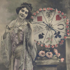 kleenexwoman: A woman in an old-fashioned dress presents a wheel of fortune. (Wheel of fortune)