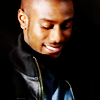 actionreaction: photo of michael obiora, looking down and smiling ([characters] dean)