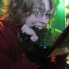 cameoflage: Self-portrait: An androgynous person with wild blond hair, glasses and a Homestuck Hero of Time hoodie biting a netbook. (delicious bytes)