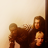 subluxate: Aldis Hodge, Christian Kane, and Beth Riesgraf as Hardison, Eliot, and Parker, crouched down (Leverage: OT3)