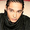actionreaction: photo of tom kaulitz, looking slightly off to the side ([characters] aksel)
