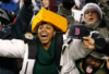 packers_fans: female cheesehead in the stands, cheering (cheesehead)