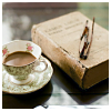 lizcommotion: tea cup, a book, and reading glasses (tea and book)