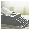 lizcommotion: typewriter on a table, faded (writing)