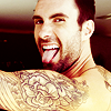actionreaction: photo of adam levine looking over his shoulder and sticking out his tongue ([characters] ezra)