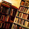jesse_the_k: Two bookcases stuffed full (with books on top) leaning into each other (books)
