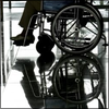 chairman: wheelchair reflected in very shiny floor (reflecto-chango!)