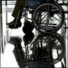 chairman: wheelchair reflected in very shiny floor (reflecto-chango!)