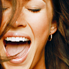 highways: [A close up image of Megan Fox, who appears to be shouting something happily.] (MEGAN ☌ smiling.)