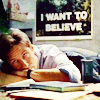 pipisafoat: mulder (tv: x-files) slumped on his desk with the iconic I WANT TO BELIEVE poster in the background (deskflop)