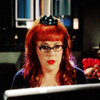 eldritch_panda: Kristin Vangess, as Penelope Garcia in Criminal Minds, with bright red hair sitting in front of her computer. (Penelope Gracia computer)