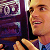 veleda_k: Neal from White Collar looking extremely happy while examining a currency plate (White Collar: Neal glee)