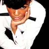wishfulclicking: janelle monae, crouching with her chin on her hand (musician: janelle monae)