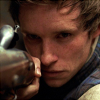 prodigy: Eddie Redmayne as Marius Pontmercy, aiming a gun. (never held a gun)