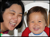 kate_nepveu: adult and toddler grinning (SteelyKid - grinning with Mom (2010-07))