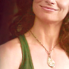 anaraine: Crop of Pamela Barnes's lower face and shoulders; she's smiling pleasantly. ([spn] smile)