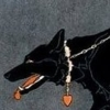 brownbetty: A black dog or wolf, wearing a collar with a heart pendant (Queen of the night)