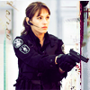 skieswideopen: Jules Callaghan from Flashpoint in uniform holding a handgun (Flashpoint: Jules with gun)