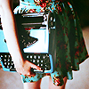 metatwaddle: girl in a light blue dress, carrying a light blue typewriter (girl carrying typewriter)