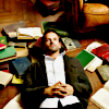 lonelywalker: Sherlock Holmes from Elementary lying on his back in his living room, surrounded by books (elementary: books)